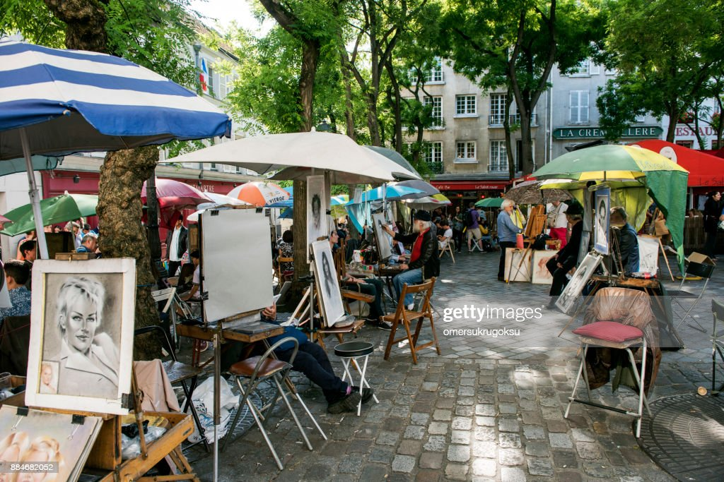 Place du Tertre Paris with artists ready to paint tourists : Stock Photo
