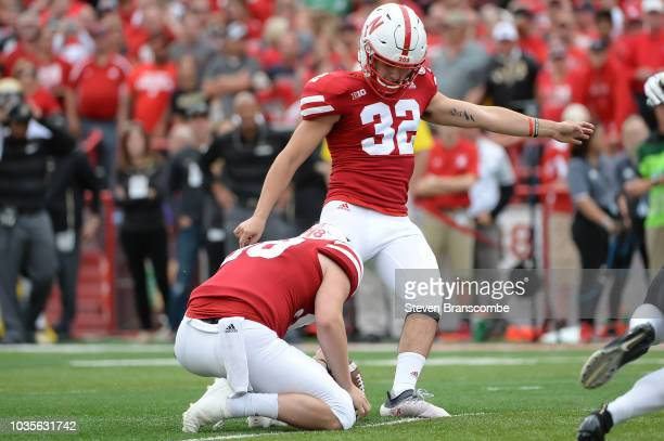 Place kicker Barret Pickering of the Nebraska Cornhuskers attempts an extra point against the Colorado Buffaloes at Memorial Stadium on September 8...