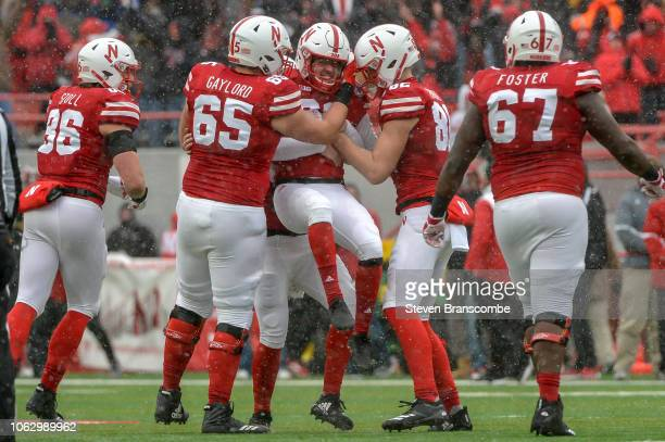 Place kicker Barret Pickering of the Nebraska Cornhuskers celebrates a go ahead field goal with teammates including offensive lineman Christian...