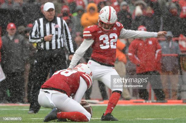 Place kicker Barret Pickering of the Nebraska Cornhuskers kicks a second half field goal against the Michigan State Spartans at Memorial Stadium on...
