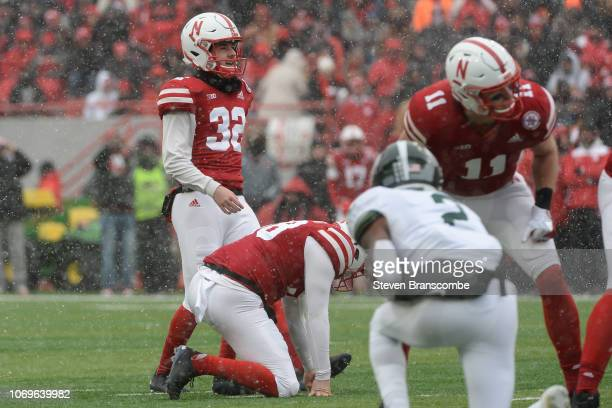 Place kicker Barret Pickering of the Nebraska Cornhuskers lines up a kick against the Michigan State Spartans at Memorial Stadium on November 17 2018...