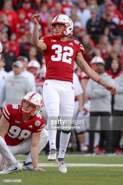 Place kicker Barret Pickering of the Nebraska Cornhuskers watches a kick with holder Isaac Armstrong against the Minnesota Golden Gophers at Memorial...