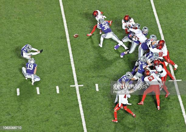Place kicker Blake Lynch of the Kansas State Wildcats kicks an extra point against the Texas Tech Red Raiders during the second half at Bill Snyder...
