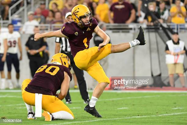 Place kicker Brandon Ruiz of the Arizona State Sun Devils kicks an extra point in the first half of the game against UTSA Roadrunners at Sun Devil...