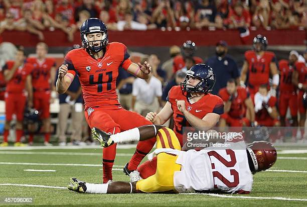 Place kicker Casey Skowron of the Arizona Wildcats falls to the field after missing a field goal past safety Leon McQuay of the USC Trojans during...
