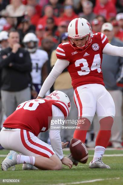 Place kicker Drew Brown of the Nebraska Cornhuskers kicks against the Northwestern Wildcats at Memorial Stadium on November 4 2017 in Lincoln Nebraska