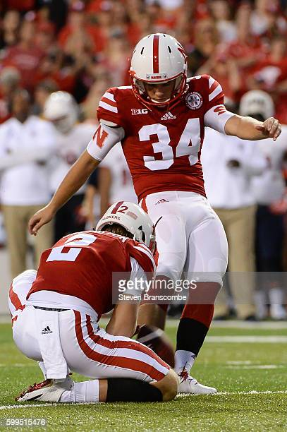 Place kicker Drew Brown of the Nebraska Cornhuskers kicks an extra point against the Fresno State Bulldogs at Memorial Stadium on September 3 2016 in...