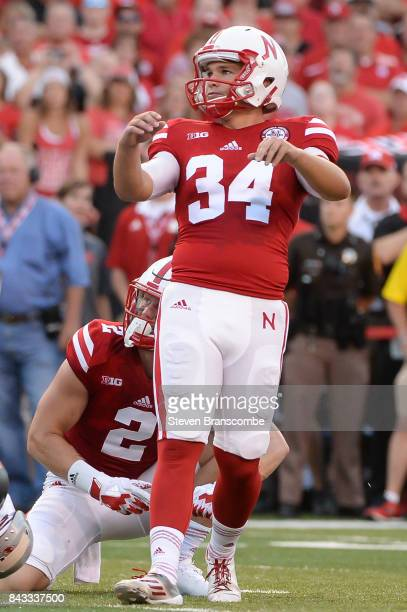 Place kicker Drew Brown of the Nebraska Cornhuskers looks at an extra point attempt against the Arkansas State Red Wolves at Memorial Stadium on...
