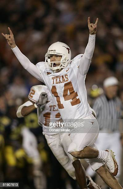 Place kicker Dusty Mangum of the Texas Longhorns celebrates kicking the game winning field goal as time expired against the Michigan Wolverines in...