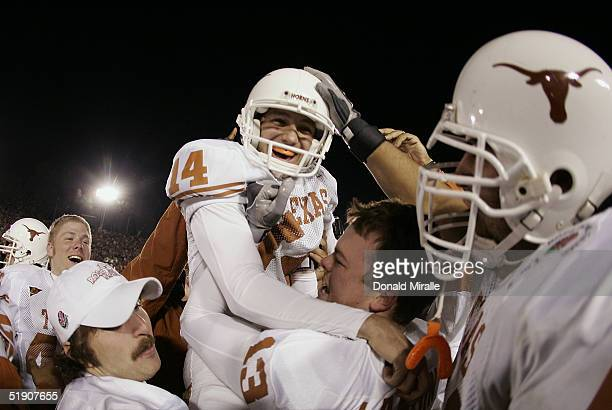 Place kicker Dusty Mangum of the Texas Longhorns is lifted on the shoulders of his teammates after kicking the winning field goal as time expired...