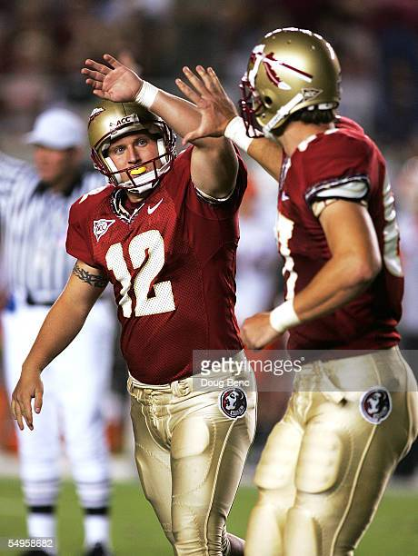 Place kicker Gary Cismesia of the Florida State Seminoles is congratulated by tight end Matt Root after Cismesia kicked a field goal in the first...