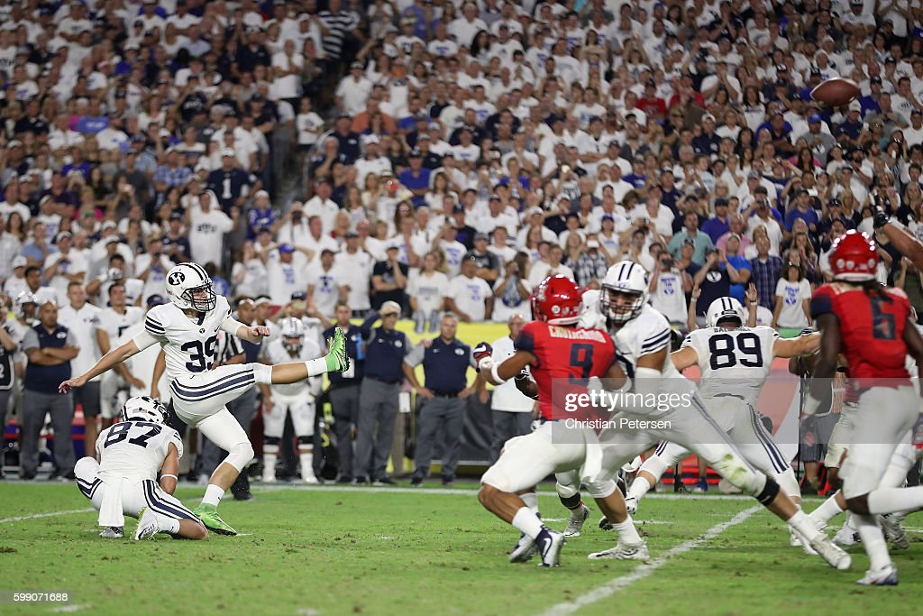 Place kicker Jake Oldroyd #39 of the Brigham Young Cougars kicks the game winning 33 yard field goal during the final moments of the college football game against the Arizona Wildcats at University of Phoenix Stadium on September 3, 2016 in Glendale, Arizona. The Cougars defeated the Wildcats 18-16.