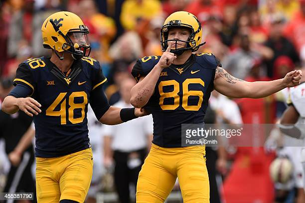 Place kicker Josh Lambert of the West Virginia Mountaineers celebrates after kicking the gamewinning field goal in the fourth quarter against the...