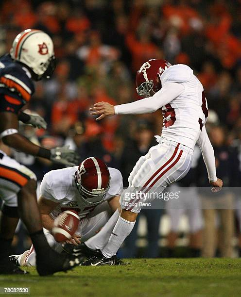 Place kicker Leigh Tiffin of the Alabama Crimson Tide kicks a 49 yard field goal out from under the hold of PJ Fitzgerald in the fourth quarter...