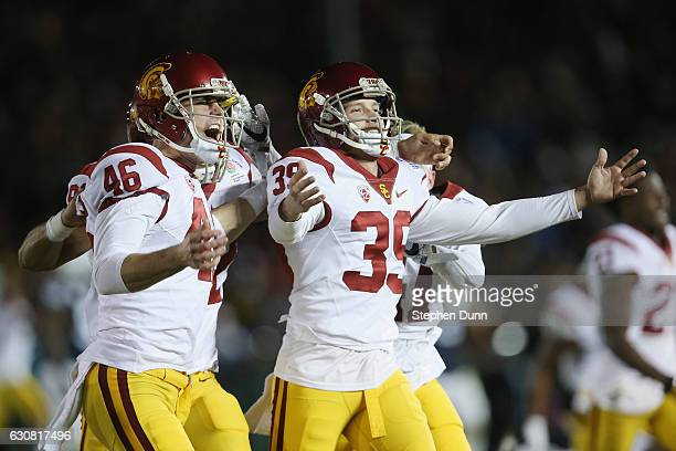 Place kicker Matt Boermeester of the USC Trojans celebrates with teammates after making the game-winning 46-yard field goal in the fourth quarter to...