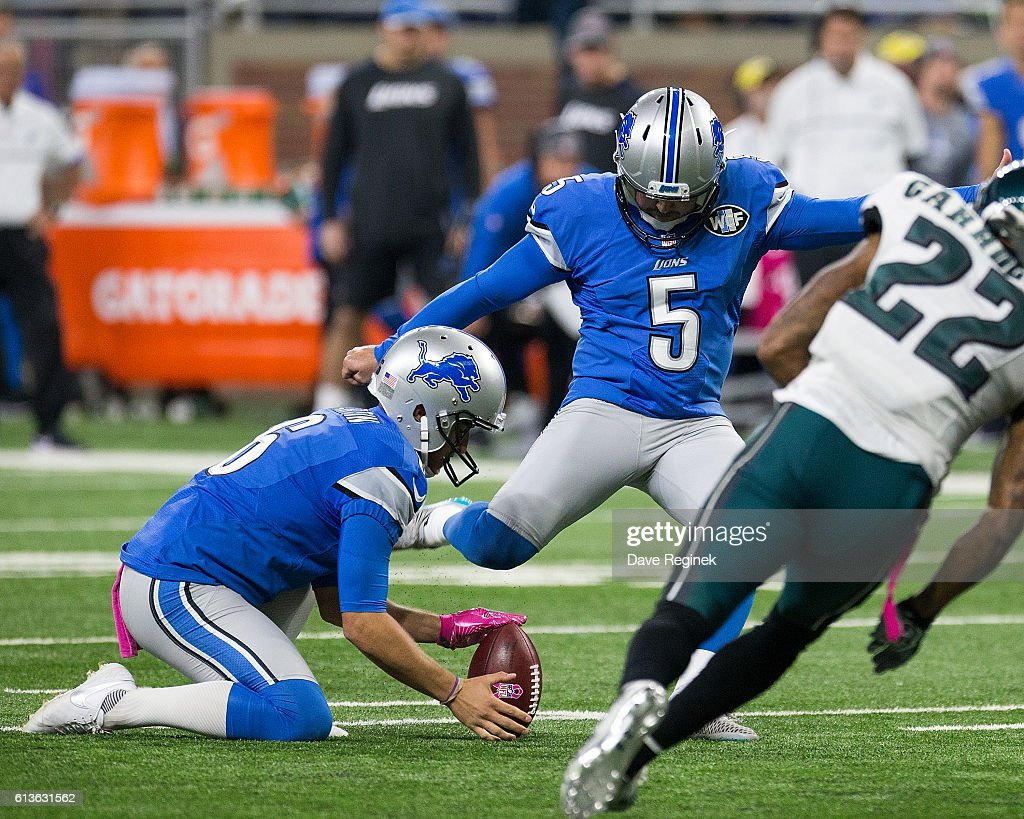 Place kicker Matt Prater #5 of the Detroit Lions kicks the winning field goal as teammate Sam Martin #6 holds the football during the fourth quarter of an NFL game against the Philadelphia Eagles at Ford Field on October 9, 2016 in Detroit, Michigan. The Lions defeated the Eagles 24-23.