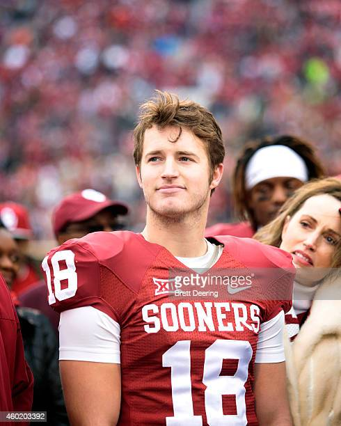 Place kicker Michael Hunnicutt of the Oklahoma Sooners watches during a ceremony for graduating seniors before the game against the Oklahoma State...