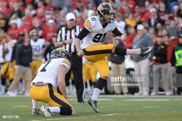 Place kicker Miguel Recinos of the Iowa Hawkeyes kicks an extra point against the Nebraska Cornhuskers at Memorial Stadium on November 24 2017 in...