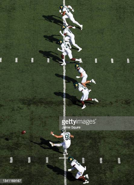 Place kicker Noah Rauschenberg of the Baylor Bears kicks off after a touchdown during the game against the Kansas Jayhawks at David Booth Kansas...