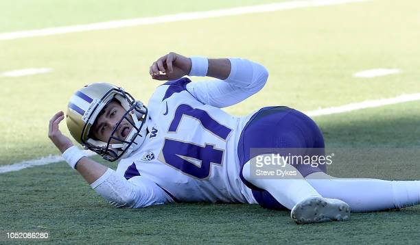 Place kicker Peyton Henry of the Washington Huskies falls to the turf goal after his field attempt to win the game misses in the final seconds of the...