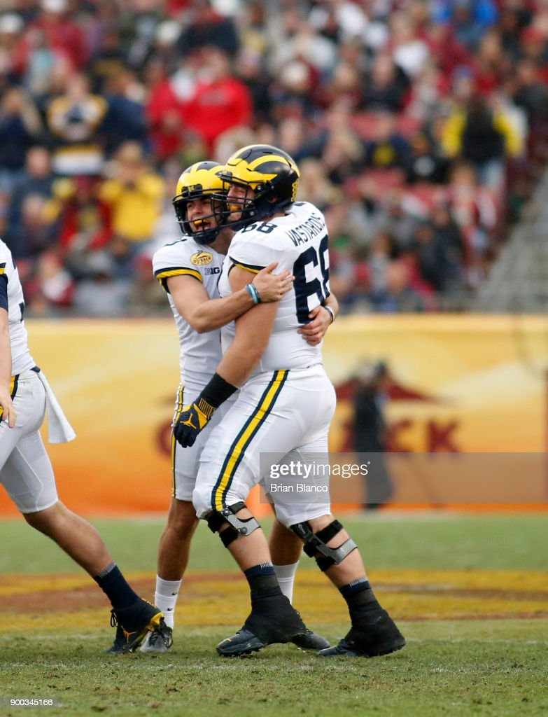 Place kicker Quinn Nordin #3 of the Michigan Wolverines celebrates with offensive lineman Andrew Vastardis #68 following his 48-yard field goal during the third quarter of the Outback Bowl NCAA college football game against the South Carolina Gamecocks on January 1, 2018 at Raymond James Stadium in Tampa, Florida.