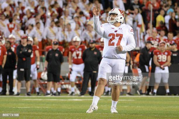 Place kicker Rafael Gaglianone of the Wisconsin Badgers prepares to kick against the Nebraska Cornhuskers at Memorial Stadium on October 7 2017 in...