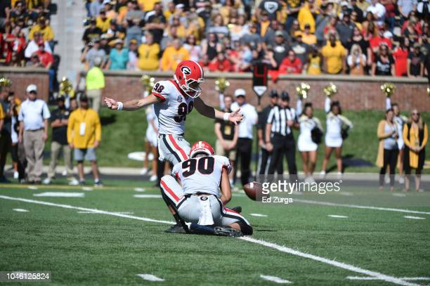 Place kicker Rodrigo Blankenship of the Georgia Bulldogs kicks an extra point action against the Missouri Tigers at Memorial Stadium on September 22...