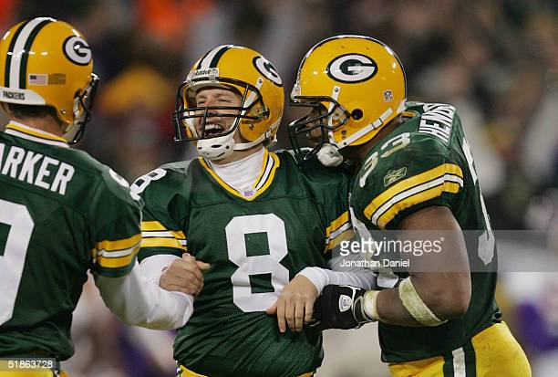 Place kicker Ryan Longwell and William Henderson of the Green Bay Packers celebrate during the game against the Minnesota Vikings at Lambeau Field on...