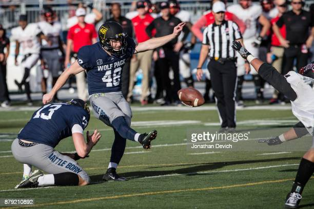 Place kicker Spencer Pettit of the Nevada Wolf Pack kicks a field goal against the UNLV Rebels at Mackay Stadium on November 25 2017 in Reno Nevada