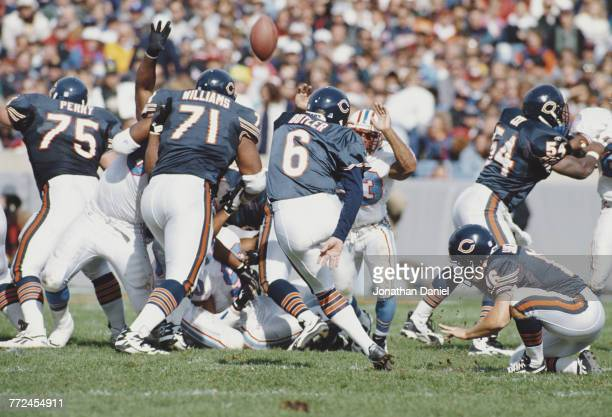 Place kicker Todd Sauerbrun looks on as Kevin Butler Kicker for the Chicago Bears kicks a field goal during the National Football Conference Central...