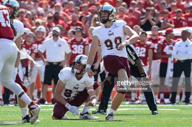 Place kicker Tyler Sumpter of the Troy Trojans and wide receiver Luke Whittemore watch a field goal attempt in the first half at Memorial Stadium on...
