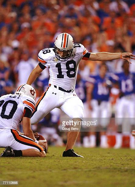 Place kicker Wes Byrum of the Auburn Tigers kicks the gamewinning kick out of the hold of Matthew Motley as time expires against the Florida Gators...