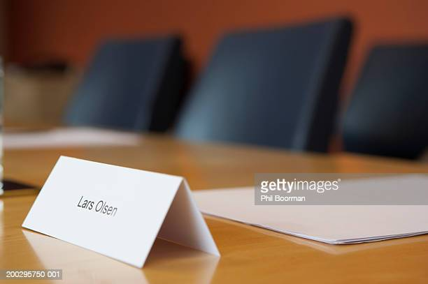 Place name tag on desk