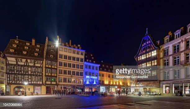 strasbourg, france - september 17, 2018: place of the cathedral, highlighted buildings at night - cathedral stock pictures, royalty-free photos & images