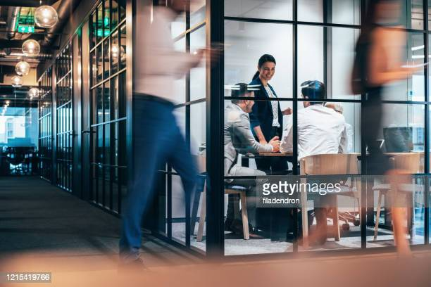 place of work - photographed through window stock pictures, royalty-free photos & images