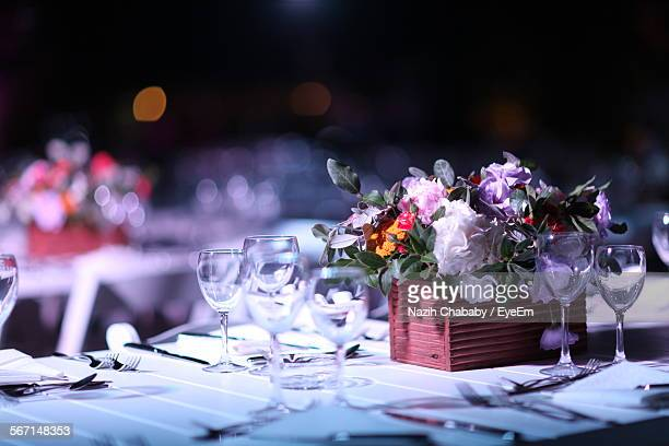 Place Setting And Bouquet On Table At Wedding Reception