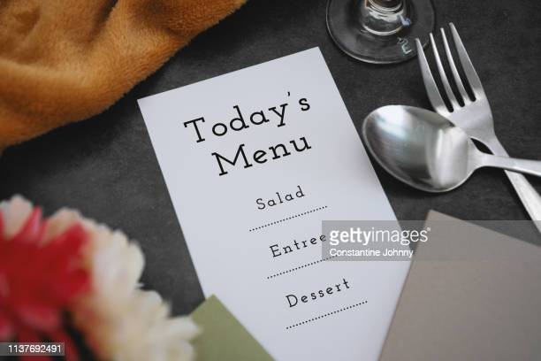 place setting and menu on dine table - empty paper plate stock photos and pictures