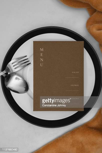 place setting and menu on dine table - menu stock pictures, royalty-free photos & images
