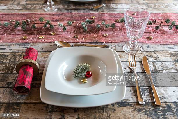 Place setting on laid table at Christmas time