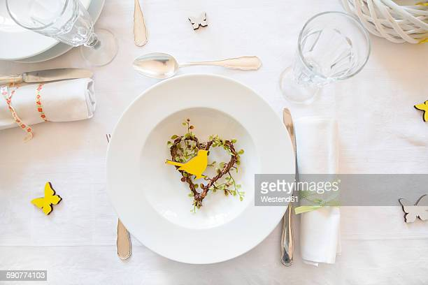 Place setting on laid table at springtime