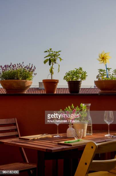 Place Setting On Table In Balcony Against Clear Sky