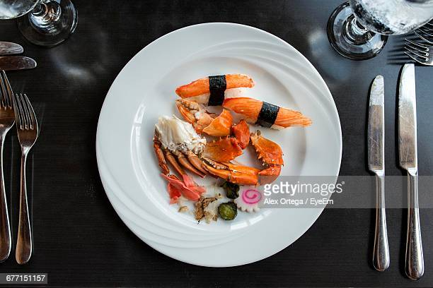 Place Setting With Crab Sticks In Plate On Dinner Table