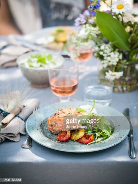 place setting with fish ready to eat - wine stock pictures, royalty-free photos & images