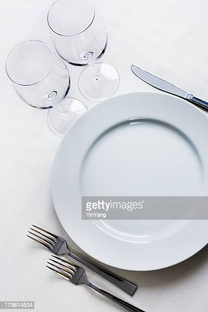 Place Setting with Plate, Silverware, Wine Glasses on White Tablecloth