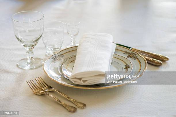 Place setting with plates, glasses, forks and knifes