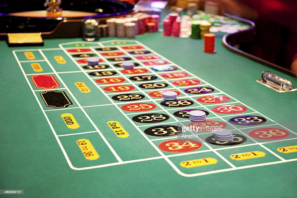 Place your bets: roulette table in the casino : Stock Photo