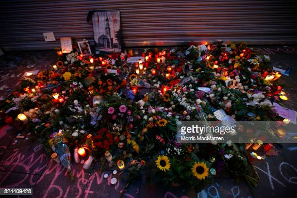 Placed flowers are seen outside the Edeka supermarket where on Friday Ahmad A killed one and injured six people with a knife on July 28 2017 in...