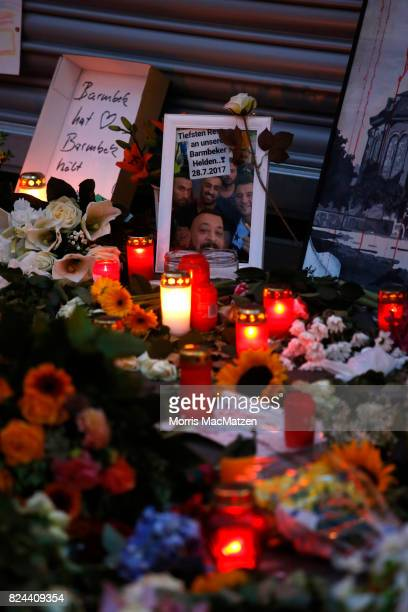 Placed flowers photographs and pictures are seen outside the Edeka supermarket where on Friday Ahmad A killed one and injured six people with a knife...