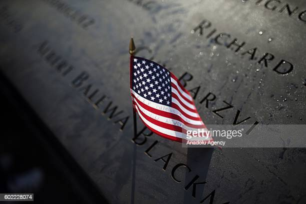 A placed US flag is seen on a name of a victim at the National 11 September memorial a day before the 15th anniversary of the 9/11 attacks in...