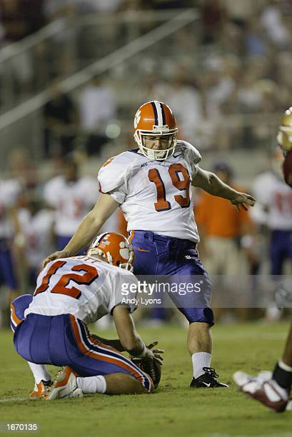 Placekicker Aaron Hunt of the Clemson Tigers kicks out of a hold by wide receiver Jeff Scott during the Atlantic Coast Conference football game...